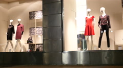 Mannequins in a store front showcase of fashionable clothes shop Stock Footage