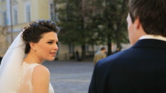 Newly married couple walk in city holding hands shot in slow motion  close up Stock Footage