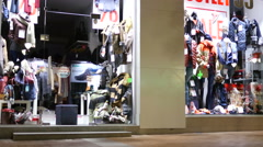 Mannequins and clothes in a store front showcase of fashionable shop in Sofia Stock Footage
