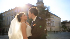 The groom kisses the bride in city shot in slow motion  close up Stock Footage