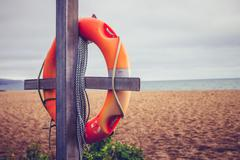 Life buoy on post at the beach Stock Photos
