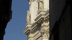 Two statues on Santa Maria della Salute Church in Venice Stock Footage