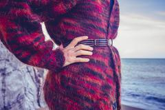 Woman in woolen jumper on the beach - stock photo