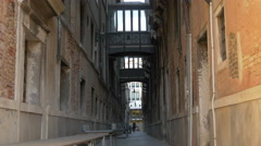 One girl walking on a street with bridges between buildings in Venice - stock footage