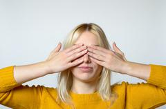 Woman Covering her Eyes with Bare Hands Stock Photos