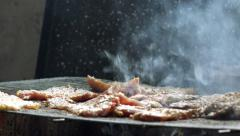Man grilling pork meat chops on barbecue Stock Footage