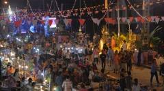 Night market and crowds at Wan Ok Phansa festival,Ubon Ratchathani,Thailand Stock Footage