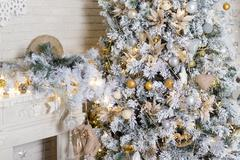 Brightly lit christmas tree with lots of gifts - stock photo