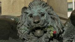Lion statue holding a rose in his mouth in Venice Stock Footage