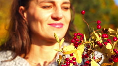 Happy woman holding bouquet of brier, steadycam shot, slow motion shot Stock Footage