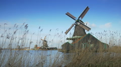 Turning windmills at the Zaanse Schans. Holland Stock Footage