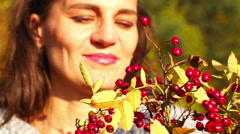 Happy woman holding bouquet of brier, steadycam shot, slow motion shot at 240fps Stock Footage