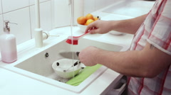 Man is washing dishes in the sink brush Stock Footage