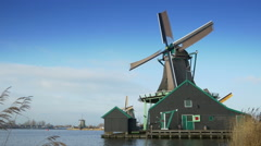 Turning windmill at the Zaanse Schans. Holland Stock Footage