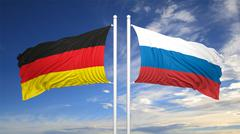 German and Russian flags against of blue sky Stock Illustration