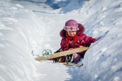 Girl crying after falling off skis Stock Photos