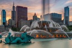 USA, Illinois, Chicago, Buckingham Fountain and skyscrapers against evening sky Stock Photos