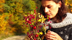 Sad woman standing with a bouquet of brier, steadycam shot, slow motion shot at  Stock Footage