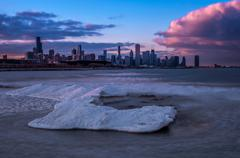 USA, Illinois, Chicago, Downtown skyline with pink sunset clouds seen from - stock photo
