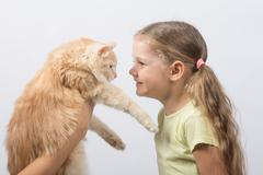 Four-year girl gave the cat - stock photo