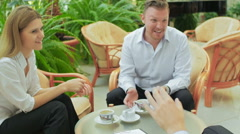 Behind a cup of coffee young businessmen discuss working plans for the future Stock Footage