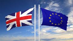 EU and British flags against of blue sky - stock illustration