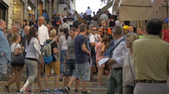 Stock Video Footage of Many tourists walking on a street with stairs and souvenir shops in Venice