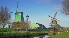 Historic wooden houses and windmills at the Zaanse Schans. Holland Stock Footage