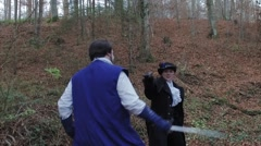 Two fencing musketeers in forest camera moves from the fight – slow motion Stock Footage