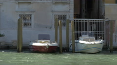 Two boats floating on the waterfront in Venice Stock Footage