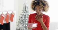 Excited young woman with an unexpected gift Stock Footage