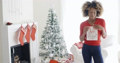 Blissfully happy young woman with a Xmas gift - stock footage