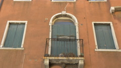 Old wooden window and door shutters and Venice - stock footage