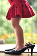 Legs of girl (2-3) in high heels - stock photo