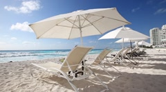 Caribbean beach with sun umbrellas and beds Stock Footage