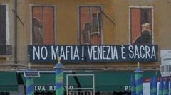 'No mafia! Venezia e sacra' sign on a building in Venice - stock footage