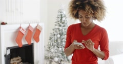 Young woman checking her Christmas messages Stock Footage