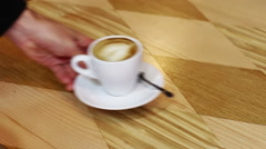 Stock Video Footage of Cup of hot coffee and cheesecake with currant on a wooden table