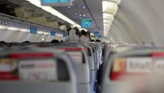 Passengers in an Airplane Putting their Cabin Baggage during Boarding. Stock Footage
