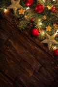 Christmas decoration with fir branches on wooden planks Stock Photos