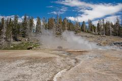 USA, Wyoming, Yellowstone National Park, Steam over hot springs Stock Photos