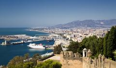 Spain, Andalusia, Malaga, Elevated view of city coastline and harbor Stock Photos