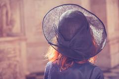 Woman in hat admiring architecture Stock Photos