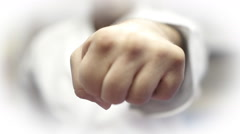Front view of karate master punching with both hands, loopable Stock Footage