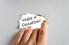 Make a donation text concept Stock Photos