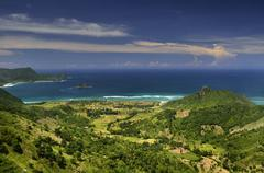 Indonesia, Serangan, Landscape with green hills and sea Stock Photos