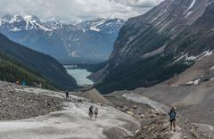 Canada, Alberta, Banff National Park, Canadian Rockies, Hikers walking in valley - stock photo