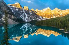 Canada, Banff National Park, Canadian Rockies, Mountains reflecting in calm lake Stock Photos