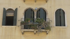 Four arched windows with window shutters in Venice - stock footage
