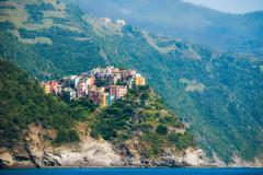 Italy, Liguria, Cinque Terre, Corniglia, Multi colored town architecture among Stock Photos